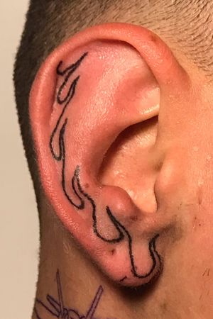 Handpoked flames on ear
