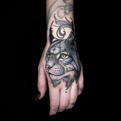 Hand tattoo by Maria Dolg #MariaDolg #tattooartist #besttattoos #awesometattoos #tattoosformen #tattoosforwomen #tattooidea #cat #Lynx #handtattoo #star #junglecat #petportrait #kitty #neotraditional