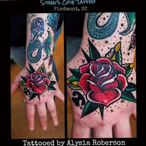 Oldschool rose tattoo by Alysia Roberson at Siren's Cove Tattoo in Piedmont, SC!! Several oldschool traditional style tattoos today on her all at once! #rosetattoo #handtattoo #traditionaltattoo #oldschooltattoo #handtatty #tattooedhand #prettytattoo #OldSchoolRose #oldschoolrosetattoo #sailorjerry #sailorjerrytattoo #tattoosiren #traditionalrosetattoo #flashtattoo #traditionalrose #flowertattoo #sleeve #sleeved #tattoos #tattooed #traditionalroses #tattooedwomen #tattooedwoman #inkedgirl #greenvillesc #clemsonsc #Alysiarobersontattoo #sirenscovetattoo www.facebook.com/sirenscovetattoo www.facebook.com/Alysia.Roberson.Tattoo.Artist