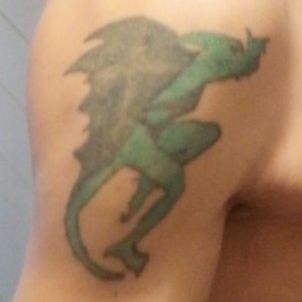 Upper left arm. Need cover up or redone.