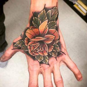 #hand #handtattoo #rose #neotraditional #color #yellow #orange #red #linework #beautiful #guy #green #tattoodo