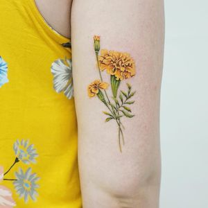 Birth month flower tattoo by Picsola #picsola #marigold #birthmonthflowertattoos #birthmonthflowers #flowertattoo #flowers #florals #petals #blooms #leaves #nature #plant #birthmonth
