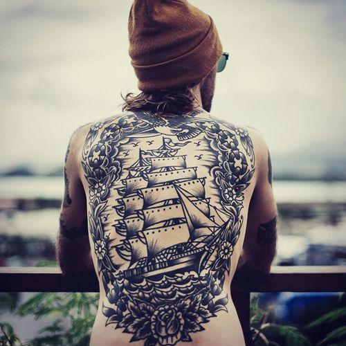 Cool tattoo by Valentin Jorquera #ValentinJorquera #cooltattoos #cooltattoo #besttattoo #tattoodoapp #tattooartists #tattooideas #tattooart #blackwork #traditional #shop #rose #eagle #chain #flowers
