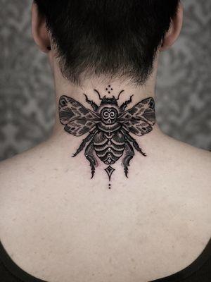 Bee on neck.