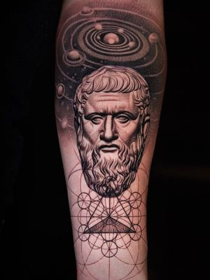 Plato and universe theme on arm.