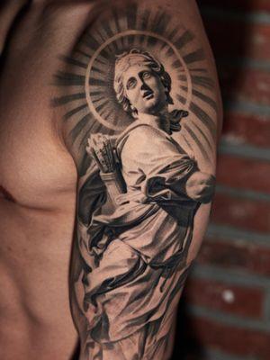 Healed Artemis statue on arm.
