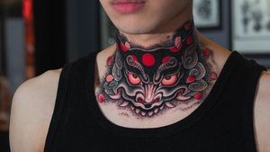 Foo dog head for cover up on the neck.