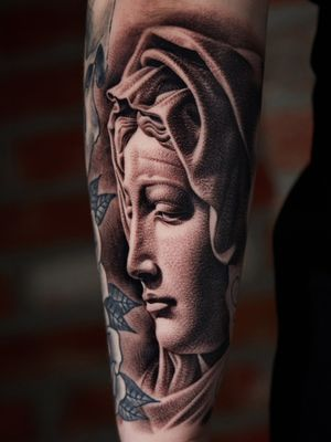 Madonna face on arm.