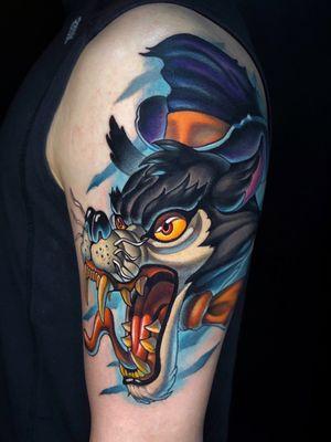 Big bad wolf on arm.