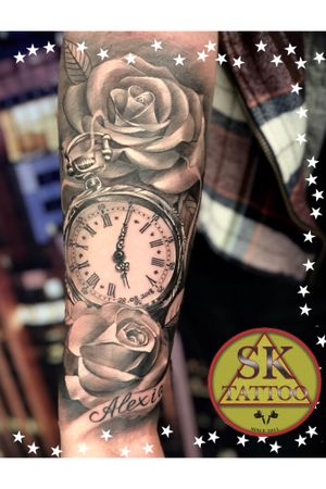 Arm tattoo womens clock and roses
