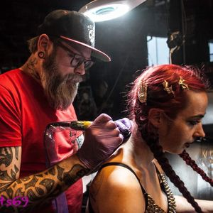 Live Tattooing at my Tattoo Easter Fest 21 of April. Vicious Rumors logo...on VR singer's girl...during their show.