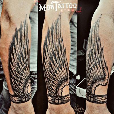 #wingstattoo #wing #arm #cross #bracelettattoo #bracelet #feathers #blackandgreytattoo