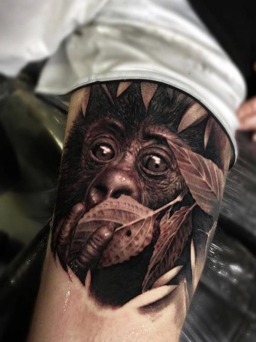 Hyperrealist tattoo by Ganga #Ganga #realism #hyperrealism #blackandgrey #animal #portrait #petportrait #leaves #nature #monkey #chimp #gorilla #cute #babyanimal