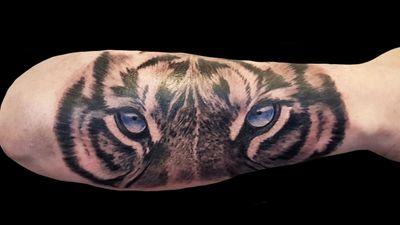 By David at sacred steel #tiger #tigereyes #animal #animaltattoo #bigcat #feline #nature #blackandgrey #animalface