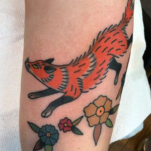 Fox tattoo by Julia Campione #JuliaCampione #foxtattoo #foxtattoos #fox #kitsune #animal #nature #color #traditional #upperarm #upperarmtattoo #flower #floral #leaves