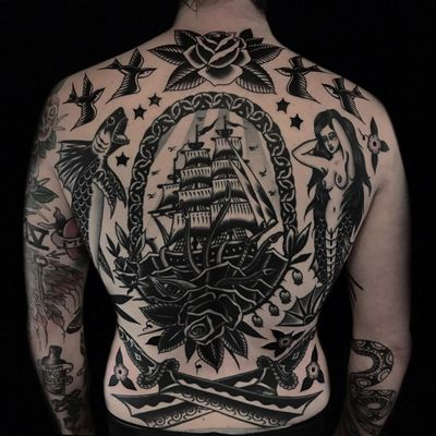 Nautical back tattoo collection by Austin Maples #AustinMaples #NauticalTattoos #sailortattoos #sailors #traditionaltattoos #traditional #AmericanTraditional #backpiece #nautical #ship #mermaid #fish #rose #sword #swallow
