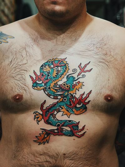Dragon tattoo by Liam Alvy #LiamAlvy #NauticalTattoos #sailortattoos #sailors #traditionaltattoos #traditional #AmericanTraditional #nautical #dragon #chest