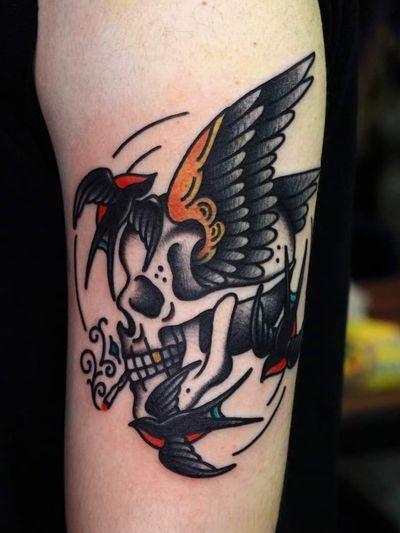 Swallow tattoo by Mick Gore #MickGore #NauticalTattoos #sailortattoos #sailors #traditionaltattoos #traditional #AmericanTraditional #nautical #swallow #skull #bird #upperarm #arm #bicep
