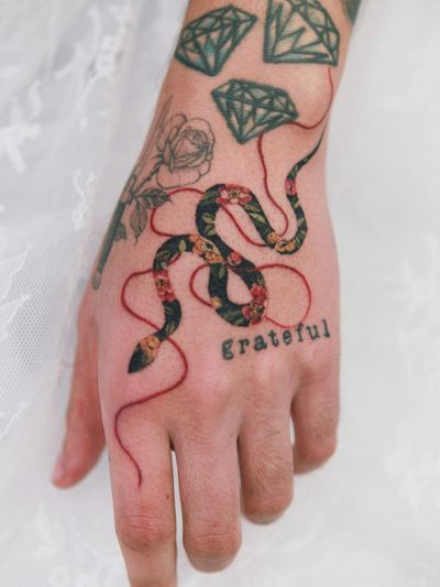 Snake hand tattoo by Sion #Sion #tattooistSion #snake #hand #flowers #peony - Top 10 Cities to Get Tattooed In #Seoul #tattooidea #tattoo #tattooart #vacation #travel #top10 #top10cities #gettattooed