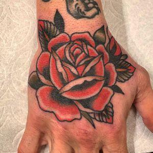 Rose tattoo by Paul Dobleman #PaulDobleman #rosetattoo #handtattoo - Top 10 Cities to Get Tattooed In #SanFrancisco #tattooidea #tattoo #tattooart #vacation #travel #top10 #top10cities #gettattooed