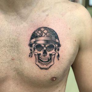 Chicano tattoo by #AlejandroLopez #chicano #chicanotattoo #blackandgrey #traditional #oldschool #illustrative #skull #helmet #death #chest