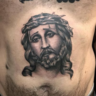 Chicano tattoo by #AlejandroLopez #chicano #chicanotattoo #blackandgrey #traditional #oldschool #illustrative #jesus #stomach #crownofthorns #religious #portrait #catholic