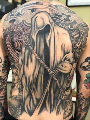 Chicano tattoo by #AlejandroLopez #chicano #chicanotattoo #blackandgrey #traditional #oldschool #illustrative #cobra #spiderweb #lips #gun #reaper #scythe #sacredheart #dice #skull #ladyhead #back #backpiece