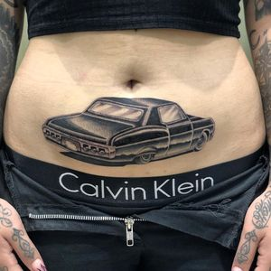 Chicano tattoo by #AlejandroLopez #chicano #chicanotattoo #blackandgrey #traditional #oldschool #illustrative #lowrider #car #stomachtattoo #stomach