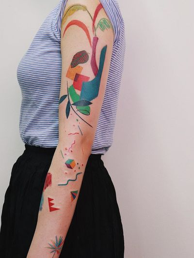 Colorful tattoo by Gong Greem #GongGreem #sleeve #arm #abstract #shapes #patterns #ornamental #floral #nature #leaves #cubism #colorfultattoo #colorful #color #vibrant