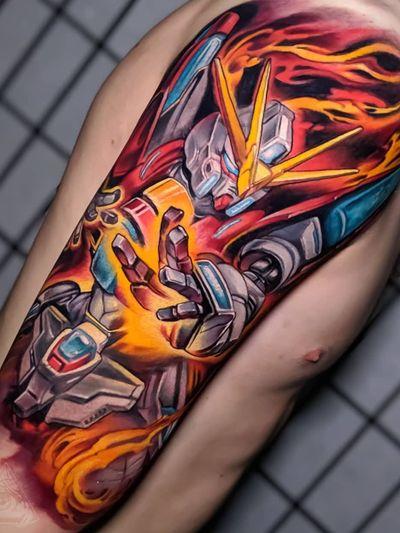 Colorful tattoo by Hori Benny #HoriBenny #halfsleeve #upperarm #arm #gundamwing #anime #manga #fire #newschool #colorfultattoo #colorful #color #vibrant