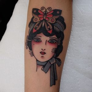 Traditional lady head tattoo by Ivan Antonyshev #IvanAntonyshev #forearm #arm #color #butterfly #bow #traditionalladyhead #traditional #oldschool #ladyhead #lady #portrait #pinup