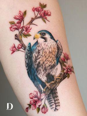 Beautiful tattoo by Deborah Genchi #DeborahGenchi #debartist #realism #realistic #illustrative #watercolor #color #falcon #bird #feathers #nature #animal #flowers #floral #treebranch #tree #upperarm #arm