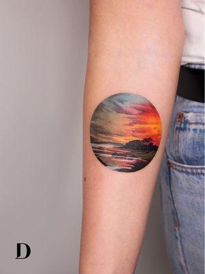 Beautiful tattoo by Deborah Genchi #DeborahGenchi #debartist #realism #realistic #illustrative #watercolor #color #sunset #beach #landscape #sky #forearm #arm #clouds