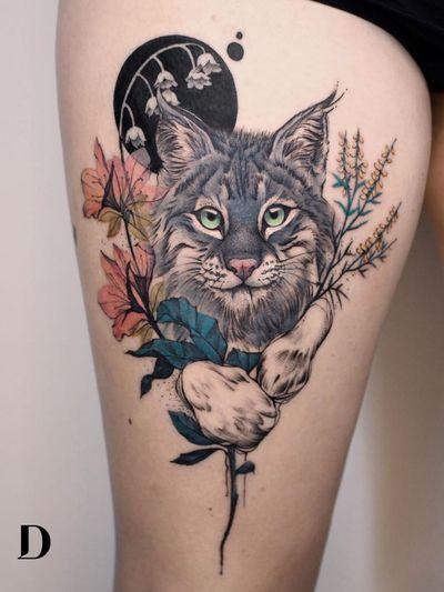 Beautiful tattoo by Deborah Genchi #DeborahGenchi #debartist #realism #realistic #illustrative #watercolor #color #cat #lynx #kitty #flower #floral #nature #leaves