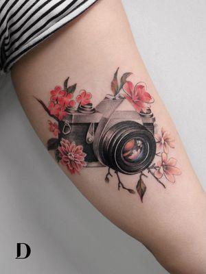 Beautiful tattoo by Deborah Genchi #DeborahGenchi #debartist #realism #realistic #illustrative #watercolor #color #camera #flowers #floral #35mm #analogfilm #upperarm #arm