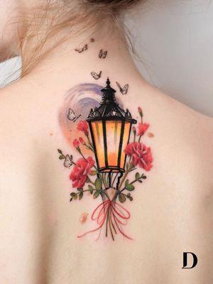 Beautiful tattoo by Deborah Genchi #DeborahGenchi #debartist #realism #realistic #illustrative #watercolor #color #lantern #candle #rose #flower #floral #butterfly #back #Upperback