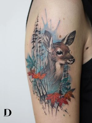 Beautiful tattoo by Deborah Genchi #DeborahGenchi #debartist #realism #realistic #illustrative #watercolor #color #deer #animal #nature #leaves #mapleleaves #upperarm #arm
