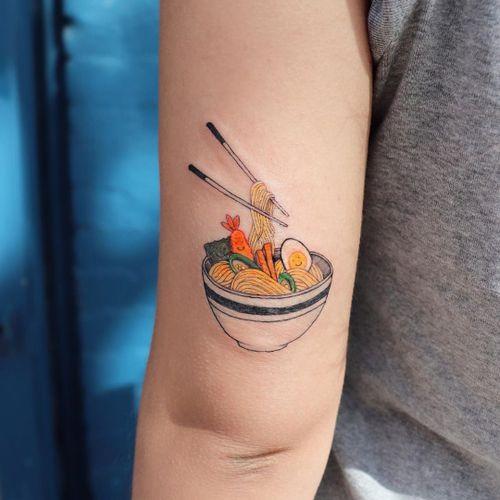 Ramen noodles tattoo by Hannah Kang #HannahKang #ramentattoos #ramennoodles #noodletattoo #foodtattoo #ramen #Japanese #chopsticks #eggs #illustrative #small #upperarm #arm