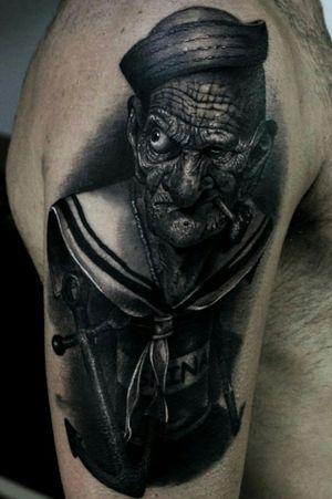 Popeye. Realistic tattoo black and grey #popeye #tatuaggiorealistico #tattooart #blackandgrey #portraittattoo #fabrizioferraro #realisticportrait #tatuaje #tattooartista #photorealistictattoos #realismtattoo #tattooartistmagazine #tattoomaster #ink #inkmaster