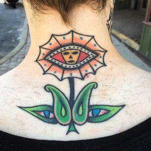 Eye tattoo by Matt Bivetto #MattBivetto #eyetattoos #eyetattoo #eye #back #color #alien #plant #flower #weird #strange #unique #surreal #surrealism