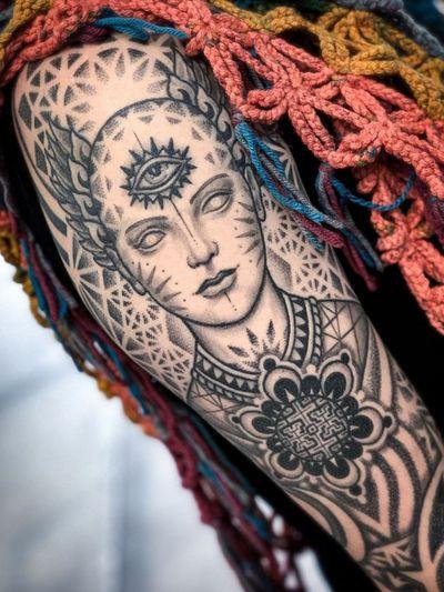 Eye tattoo by Aries Rhysing #AriesRhysing #eyetattoos #eyetattoo #eye #arm #portrait #pattern #buddhist #thirdeye #sacredgeometry #blackandgrey #illustrative #ornamental #dotwork #flower