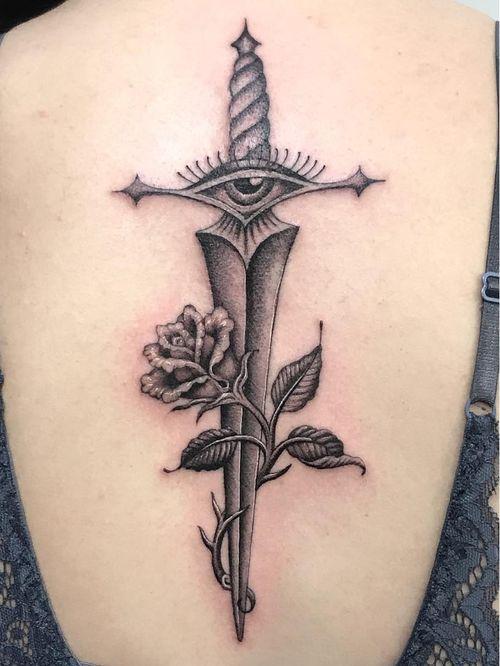 Eye tattoo by Sarah Schor #SarahSchor #eyetattoos #eyetattoo #eye #back #dagger #sword #rose #flower #floral #leaves #thirdeye #blackandgrey #Oldschool