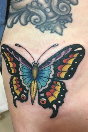 Traditional-inspired butterflu on upper thigh