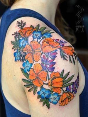Custom california wild flower shoulder tattoo #colortattoo #flowertattoo #wildflower #poppies #poppy #lupine #california #skull #neotrad #neotraditional