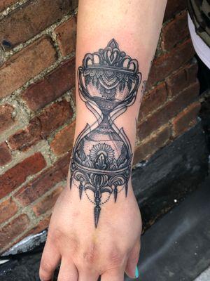 Hourglass ornamental blackwork wristlet