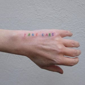 Minimal tattoo by Victor Zabuga #VictorZabuga #minimaltattoos #minimal #smalltattoos #small #simpletattoo #simpletattoos #hand #takecare #words #lettering #handpoke #color
