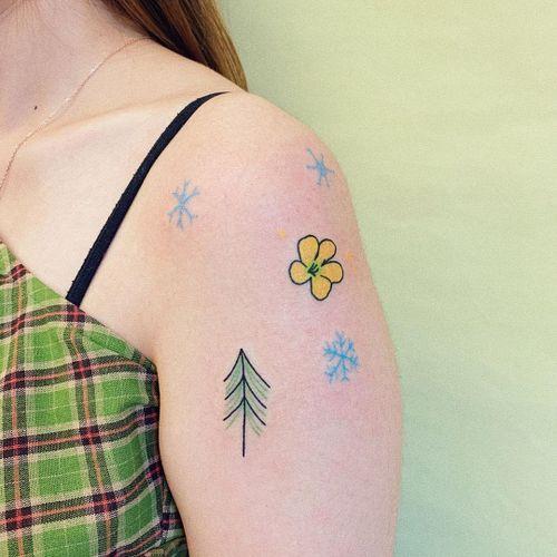 Minimal tattoo by Take My Muse #TakeMyMuse #minimaltattoos #minimal #smalltattoos #small #simpletattoo #simpletattoos #illustrative #snowflake #flower #tree #arm #color