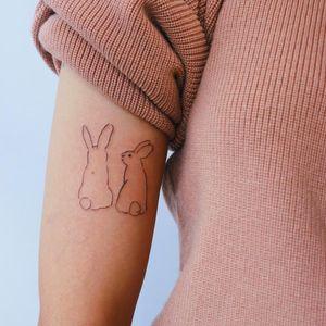 Minimal tattoo by Gong Greem #GongGreem #minimaltattoos #minimal #smalltattoos #small #simpletattoo #simpletattoos #rabbit #bunny #illustrative #arm