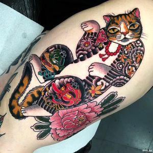 Cat tattoo by Iris Lys #IrisLys #cattattoos #cattattoo #cat #kitty #cute #animal #petportrait #pet #monmoncat #japanese #peony #mapleleaf #chrysanthemum #yokai #tattooedtattoo #tengu #masks #leg