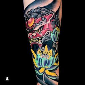 Japanese foo dog and lotus flowers.